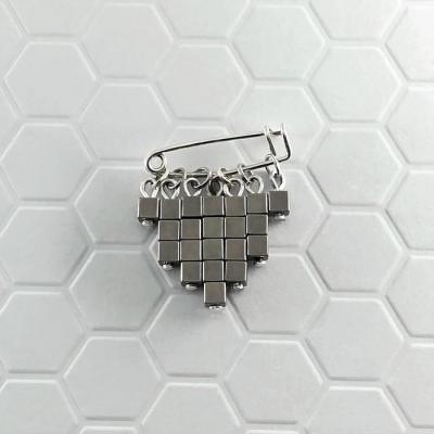 Broche Cubic acier
